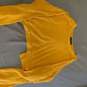 Open-back yellow sweater crop top